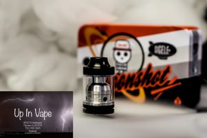 Sigelei Moonshot 200W Capable Two Post RTA by Suprimo Designed in Northern California The Sigelei Moonshot Two Post RTA is a compact rebuildable tank atomizer aimed directly at a recreating high powered RDA experience with the benefits of a tank reservoir, combining a wide surface area 13mm by 1mm dual adjustable airflow with dual 5mm diameter inner airholes, a two post build deck, a gold plated non redirected positive pin, and quad 3mm diameter wick ports that result in staggering overall capability. Designed to compete with high power capable RDAs, the Moonshot measures a compact 32mm from base to drip tip base, maintaining a well balanced profile. Using the wide area top fill system, users can easily fill the 2ml tank capacity. The Moonshot's build deck features a two post design with one 2mm diameter terminal per post, allowing for easy mounting of dual coil builds. Utilized in conjunction with the locking well, high power builds driven up to 200W can be achieved with steady wicking rates, as the Moonshot features quad 3mm diameter wicking ports. For maximum conductivity, a 24K Gold Plated Center Pin features a direct to contact design resulting in minimal voltage drop due to the lack of redirection of electrical current. The build deck and chimney system is designed to be smaller chambered than typical build decks, creating a higher level of flavor delivery. To feed the potential of the system, dual 13mm by 1mm airslots direct airflow into two 5mm diameter airholes located in the build deck, allowing for absolutely massive vapor production. The wide area airflow also delivers cooling to a wider surface area in the subdeck, effectively cooling the entire system. Combining the form factor and capability of a RDA with the reservoir of a tank, the Sigelei Moonshot 200W Two Post RTA by Suprimo is a high performance platform designed for extreme vapor chasing. Product Features: 22mm Diameter 2ml Tank Capacity Dual Adjustable Airslots 13mm by 1mm Each Airslot 5mm Diameter Inner Bottom Airflow Active Cooling Wide Surface Area Cools Entire Subdeck and Deck of RTA Two Post Built Deck Single Terminal Design 2mm Per Terminal Direct to Contact 24K Gold Plated 510 Non Redirected Superior Conductivity Minimal Voltage Loss Quad 3mm Diameter Wick Ports Flow Precision Achieves Optimal Liquid Flow Internal Cutouts Lock Sleeve Into Place Small Chambered System Maximum Flavor PEEK Insulator Threaded Top Fill System Dual Wide Area Fill Ports 9mm Diameter Competition Bore Delrin Drip Top 32mm Height from Base to Drip Tip Base High Quality Stainless Steel and Glass Construction Product Includes: One Sigelei x Suprimo Moonshot 200W Capable Two Post RTA Additional Glass Tank Section Additional Hex Keys, Screws, and O-Rings Stylized Tin Packaging Warning: Never use a short or flat 510 connection on any hybrid or hybrid style device. If unsure whether this pertains to your particular set-up, DO NOT assemble and use. Always use proper precautions and handling. Advanced User Item. Use At Your Own Risk! Vape Denver